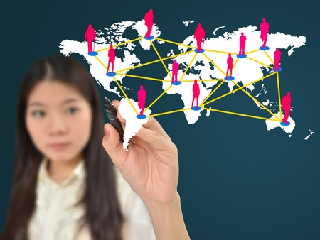 Business woman drawing social network on world map photo