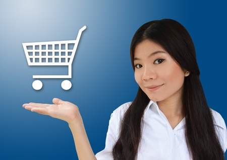 Business woman showing cart for e-commerce symbol photo