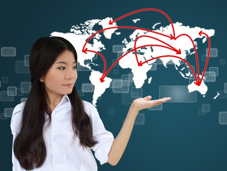 social networking: Business woman presenting network on world map