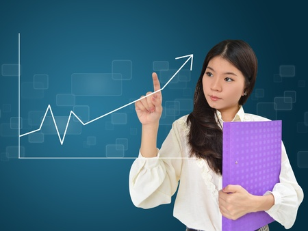upward graph: Business woman and a graph showing growth of business
