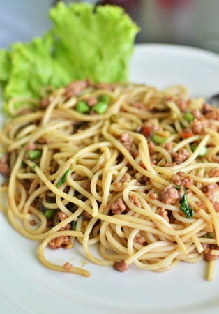 Spicy fried spaghetti with pork , Asian style food photo