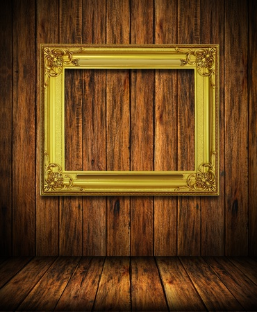 Old antique gold frame on wood wall room background photo