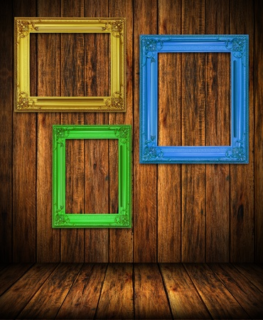 Old antique colorful frame on wood wall room background photo