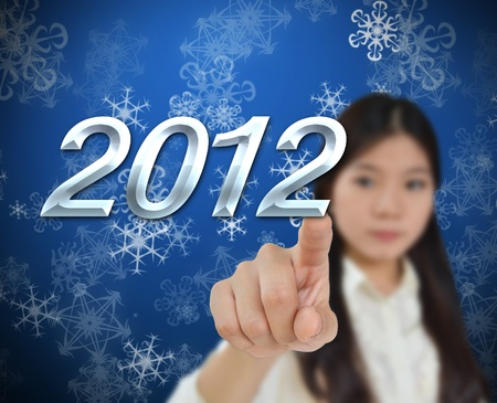 Young woman with 2012 new year background Stock Photo - 11171195