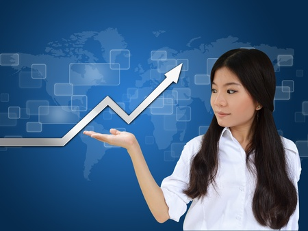 Business woman and a graph showing growth of business photo
