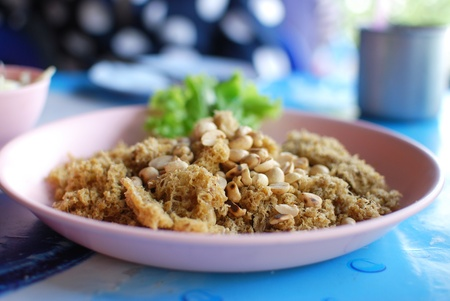 Spicy salad of fried minced fish , Asian style food in Thailand Stock Photo - 11738288
