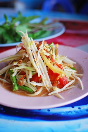 Thai papaya salad hot and spicy mixed from variety of vegetable closeup , also know as Som Tam photo