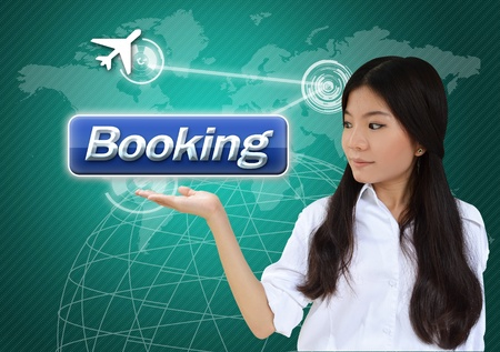 online world: Woman with booking button on world map background