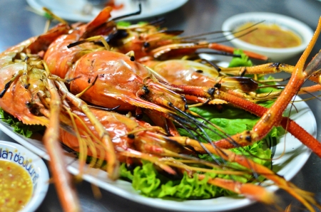 Grilled shrimp with spicy sauce , closeup , Asian style food , Thailand photo