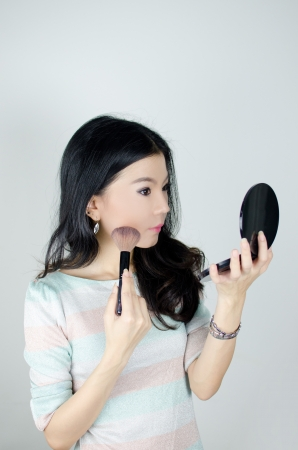 Asian woman make up with cosmetics accessories photo