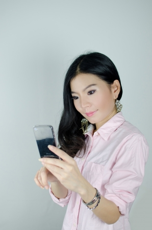 Asian woman using smartphone , communication concept photo