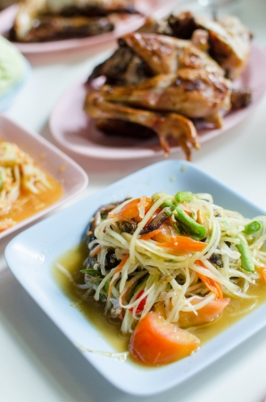 Thai papaya salad hot and spicy mixed from variety of vegetable , also know as Som Tam Stock Photo - 19018779