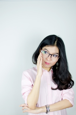 Young Asian woman with glasses thinking about work photo