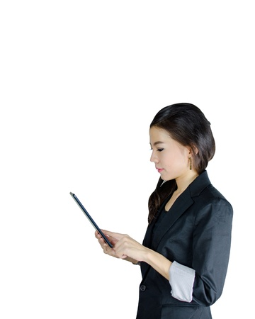 Young Asian woman using tablet computer isolated on white photo