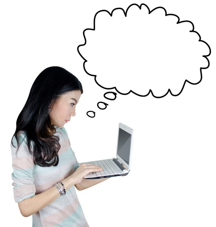 Young Asian woman using laptop computer with speech bubble icon Stock Photo - 19359008
