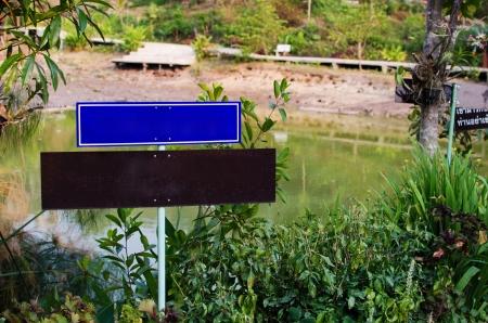 Empty signboard in the fresh green garden photo