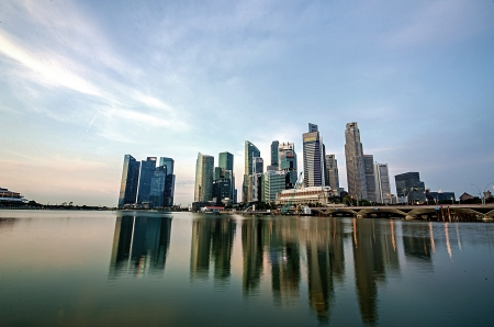 singapore city: Singapore city skyline view of business district with beautiful sunrise sky background Stock Photo