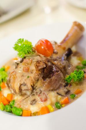 Roasted lamb leg steak on mix vegetables and mashed potato photo