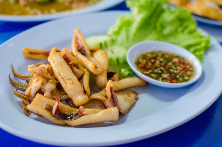 iodine: Deep fried squid with spicy sauce and lettuce Stock Photo