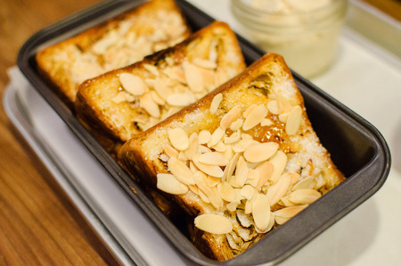 Sliced breads baked with almond butter and sugar photo