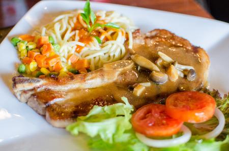 grilled pork chop: Grilled pork chop steak set with vegetables and sauce