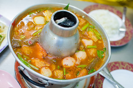 Thai hot and spicy soup seafood with fishballs and vegetables , also know as Tom Yum Goong photo