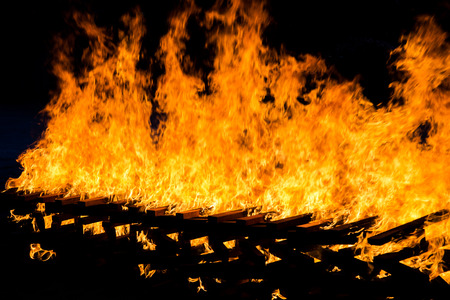 smolder: Fire burning wood pile , closeup abstract background
