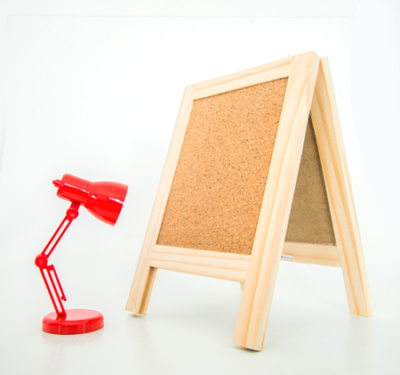 lamp stand: Wood display corkboard with alarm clock on white background