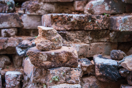 ruins: Old and broken red stone brick wall, close up details background Stock Photo