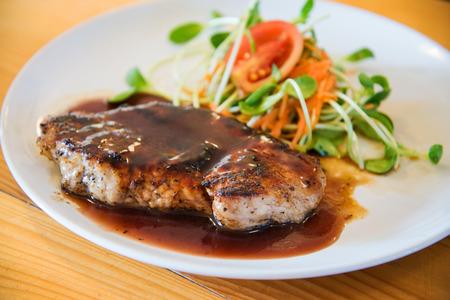 pork chop: Juicy and tasty grilled pork steak with pepper sauce
