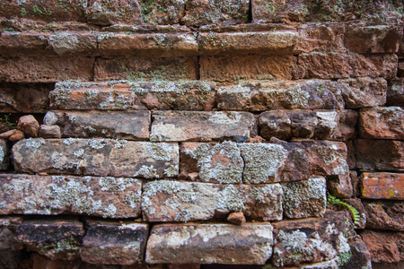 details: Old and broken red stone brick wall, close up details background Stock Photo