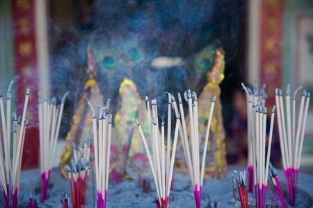 cremation: Burning incense joss sticks in chinese temple Stock Photo