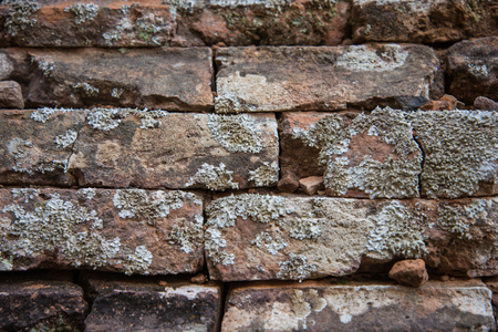 the details: Old and broken red stone brick wall, close up details background Stock Photo