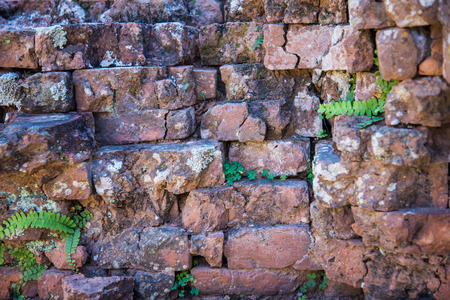 stone wall: Old and broken red stone brick wall, close up details background Stock Photo