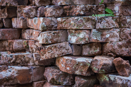 old ruin: Old and broken red stone brick wall, close up details background Stock Photo