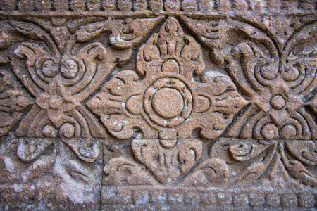 the details: Vintage style carving art on stone brick wall, Close up details background Stock Photo