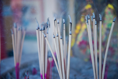 Burning incense joss sticks in chinese temple