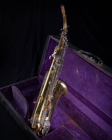 Buescher Alto Sax, Gold Lacquered in Deep Purple Velvet-Lined Hard Case back 2 on black background