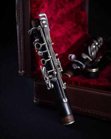 Vintage Bundy Wood Body Clarinet in Original Red Velvet-Lined Hard Case piece stem on dark background