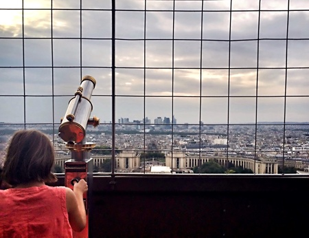 second floor: Little girl with red dress in the second floor of Eiffel Tower Paris