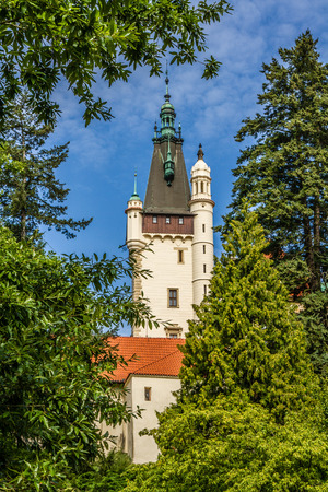 View of Castle Tower behind Green Trees - Pruhonice, Czech Republic
