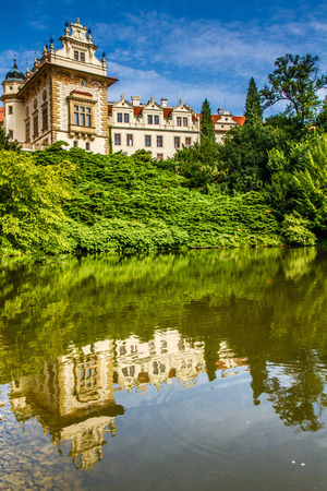 Castle with reflection in pond and blue sky - Pruhonice, Czech Republic