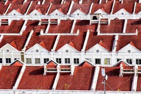 row house: Close View on Red White Terraced Houses - Melaka, Malaysia