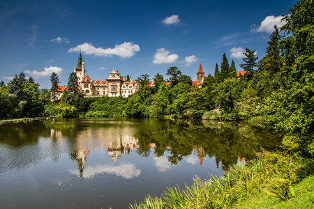 unesco in czech republic: Castle with reflection in pond and blue sky - Pruhonice, Czech Republic