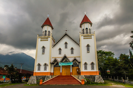 flores: Christian church with dramatic storm clouds - Flores, Indonesia