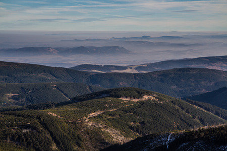 inversion: Mountain Landscape with trees and meadow during Inversion - Krkonose,Czech republic