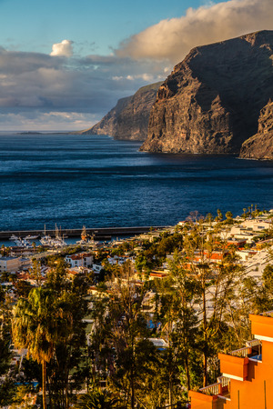 neighbouring: View on Los Gigantes and neighbouring city during Sunset - Los Gigantes, Tenerife, Canary Islands, Spain