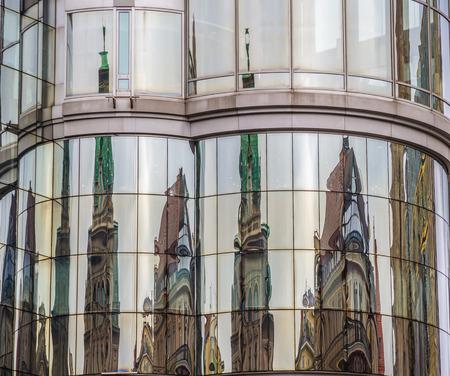 stephansplatz: Reflection of  cathedral on office building - Stephansplatz, Vienna, Austria Stock Photo