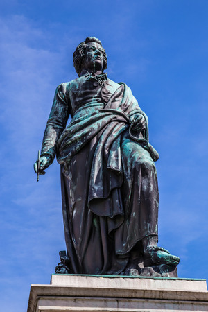 mozart: The statue of W.A.Mozart in the Mozart Square in Salzburg with deep blue sky-Austria,Europe Editorial