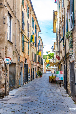 Narrow Romantic Street of Albenga - Albenga, Savona, Liguria, Italy Stock Photo